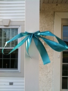 The ribbon to support Ovarian Cancer Awareness on my front porch